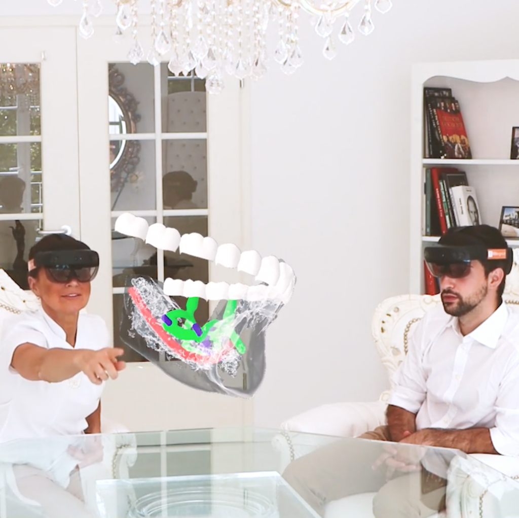 With ObiScanner Mixed Reality Module the dentist and the patient, wearing Microsoft HoloLens, are watching on hologram of the patient's mouth. The dentist is explainig the patient about the treatment, for the best communication