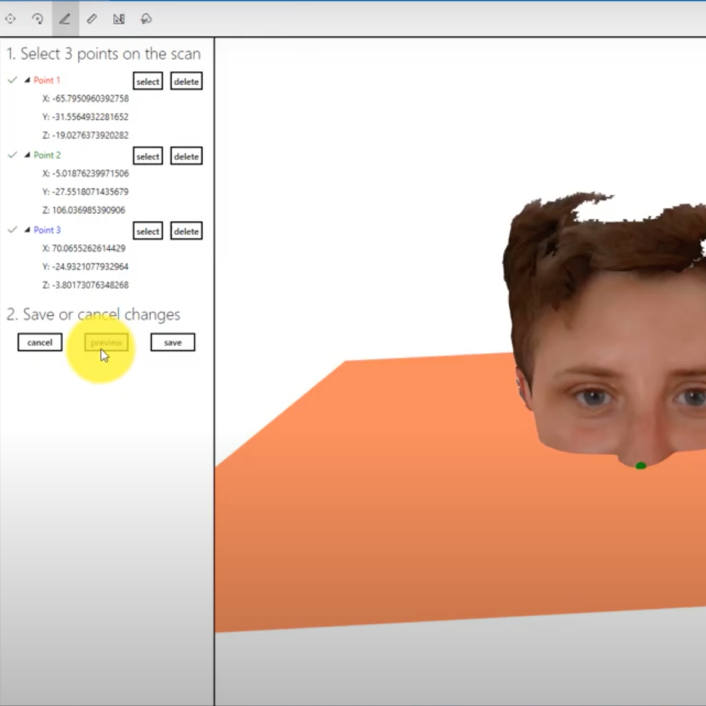 A screenshot from ObiScanner Otho Module. The dentist has added a reference plan on the patience's face 3d model